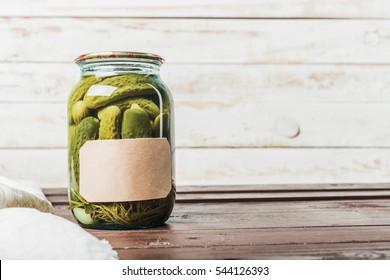 Preserved vegetables on wooden background