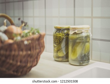 preserves in a modern kitchen,two jars with pickled cucumbers