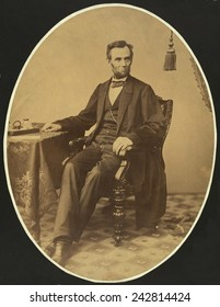 President Abraham Lincoln, approx. a week before the Gettysburg Address. The full length portrait shows Lincoln's long legs and big feet that were often caricatured by cartoonists. November 8, 1863.
