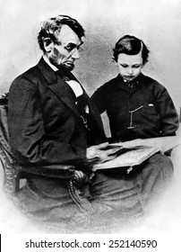 President Abraham Lincoln and son William Wallace Lincoln, early 1860s.