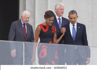 President Barack Obama, Michelle Obama, presidents Jimmy Carter and Bill Clinton commemorate the 50th anniversary of the March on Washington for Jobs and Freedom August 28, 2013 in Washington, DC.