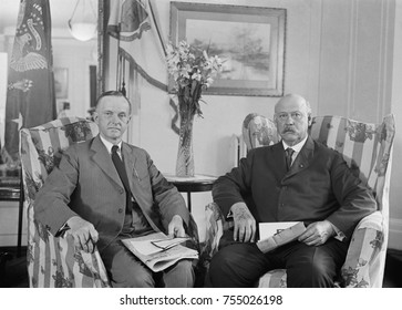 President Calvin Coolidge meeting with Secretary of War, John Weeks, on August 3, 1923. They met in the Coolidge family residence at the Willard Hotel. Coolidge became President the previous day when