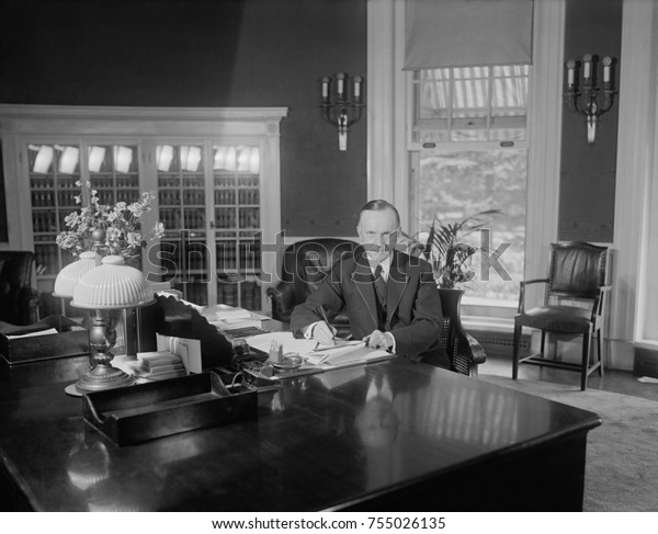 President Calvin Coolidge at the same desk used by Harding in the Oval Office. Photo was published on Aug. 14, 1923, less than two weeks after the death of Warren Harding. Florence Harding was upset t