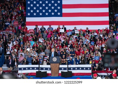 President Donald Trump smiles with a cheering crowd at the Richmond, Kentucky 10.13.18 MAGA rally