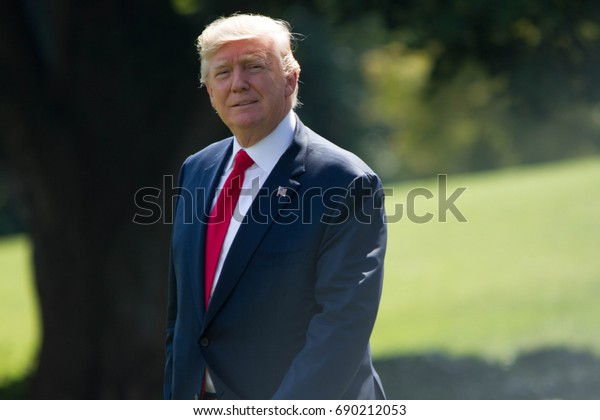 President Donald Trump walks from the west wing of the White House to Marine One before heading to Joint Base Andrews and on to Bedminster, NJ, Friday, August 4, 2017.