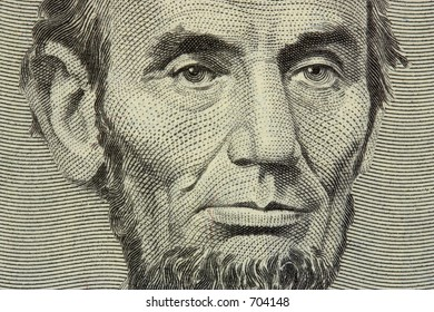 president Lincoln face on the five dollar bill