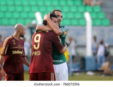 President Prudente, Brazil, November 11, 2011. Players Fred and Barcos embrace each other before starting the game Fluminense vs. Palmeiras for the Brazilian football championship in Prudentão stadiu.