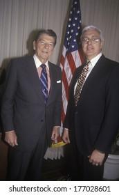 President Ronald Reagan and a politician posing