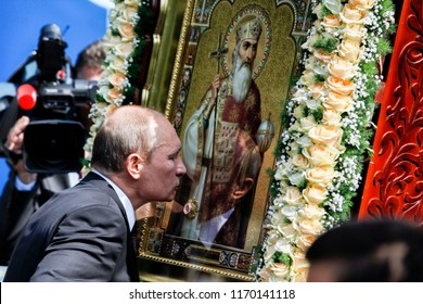 President of Russian Federation Vladimir Putin  kisses the icon of St. Volodymyr after liturgy. Kyiv, Ukraine. 27-07-2013