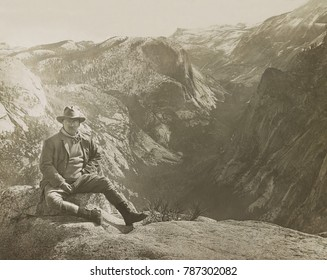 President Theodore Roosevelt sitting on large stone, Glacier Point at Yosemite, May 17, 1903. In 1908 the US government established the Muir Woods National Monument in Marin County, California