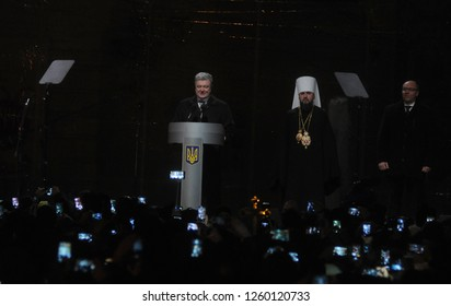 President of Ukraine Petro Poroshenko and the newly elected head of the independent Ukrainian Orthodox Church Metropolitan Epiphanius at the St. Sophia Cathedral in Kiev, Ukraine, December 15, 2018.