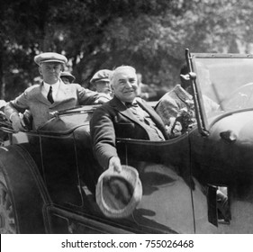 President Warren Harding riding in a car in Florida, March 1923. On a golf vacation with friends he became tired before he finished each round of golf, indicating his health was declining.