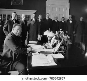 President William Howard Taft, signs New Mexico into statehood at the White House. The signing was witnessed by dignitaries on Jan. 6, 1912
