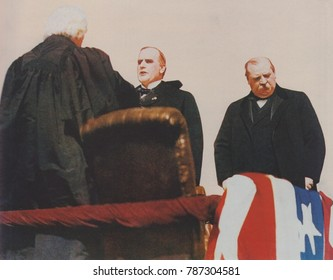 President William McKinley takes the oath of office from Chief Justice Melville Fuller. At right stands outgoing President Grover Cleveland, who lost the 1896 election to McKinley. March 4, 1897