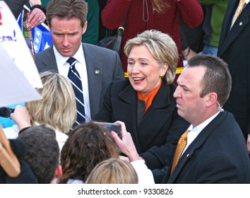 presidential candidate Hillary Clinton shaking supporters' hands at a rally in Spokane washington