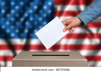 Presidential election in United States of America. The hand of woman putting her vote in the ballot box. American flag on background.