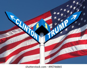 Presidential elections in the US. Names of Clinton and Trump written in a directional road signs over american flag