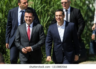 Prespes - Greece, June 17, 2018 : Greek Prime Minister Alexis Tsipras and his Macedonian counterpart Zoran Zaev walking before a signing agreement for Macedonia's new name in the village of Psarades