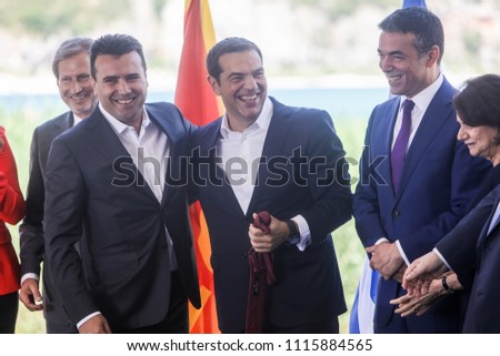 Prespes - Greece, June 17, 2018 : Greek Prime Minister Alexis Tsipras(R) and his Macedonian counterpart Zoran Zaev(L) during a signing agreement for Macedonia's new name in the village of Psarades