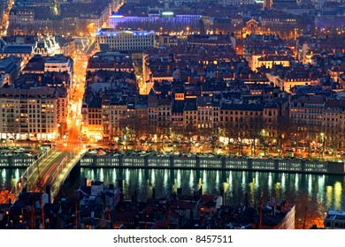 The presqu'ile of lyon at night between the Rhone and the Soane