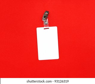 Press badge or ID pass with clip isolated on red background