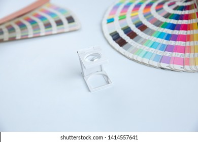 Press color management. Cmyk stripe loupe and color palette on the white background.