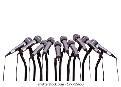 press conference with microphones on white background