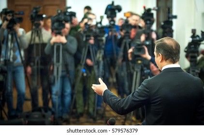Press conference. Public speaker giving talk to Television camera. News conference. An event with a video camera. press and media in public news coverage event for reporter and mass communication