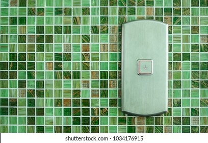 Press the elevator Down and keypad elevator With Green Tile wall