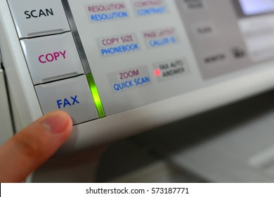 Press fax button and LED lighting on a fax machine