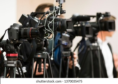 press and media photographer on duty in public news coverage event for reporter and mass communication