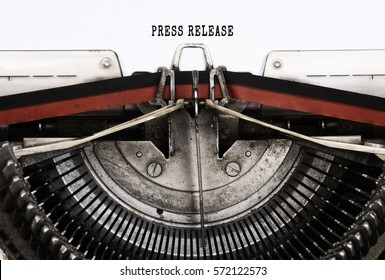 PRESS RELEASE word typed on a vintage typewriter.