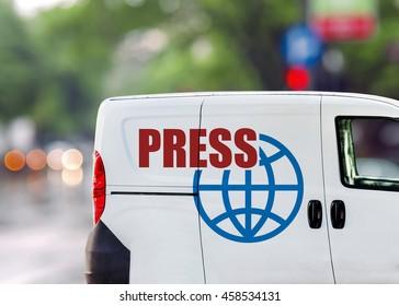 Press van on city street