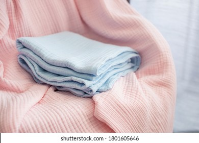 Pressed muslin, blue and pink baby blankets. Fabric, textiles, clothing concepts closeup