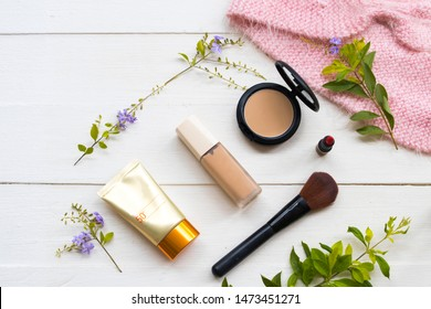 pressed powder ,lipstick color ,foundation ,sunscreen spf50 ,brush cosmetics beauty makeup for skin face of colorful lifestyle woman relax summer arrangement flat lay style on background white wooden