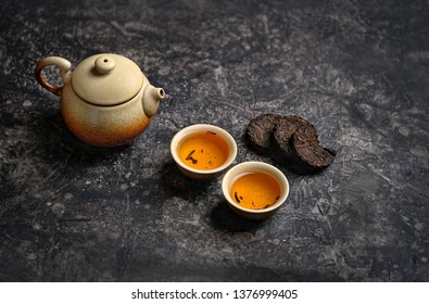 pressed pu-erh Chinese tea, variety of fermented tea produced in Yunnan province, China, cups of tea and teapot, Asia culture design concept. tea ceremony, Chinese or japanese traditions. copy space