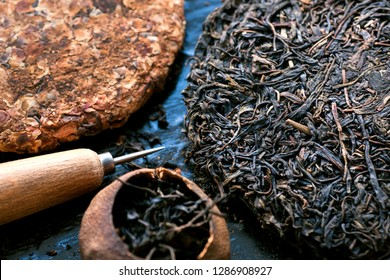 Pressed pu-erh tea, pu'er in tangerine, blooming tea cakes and knife for drinking ceremony. Traditional chinese beverage and popular antioxidant drink from China.