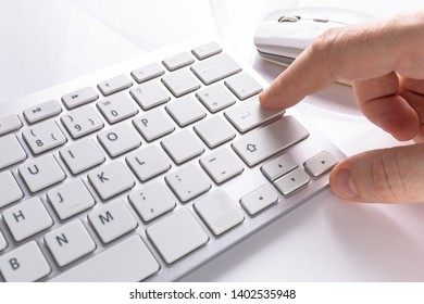 Pressing enter button on the computer keyboard