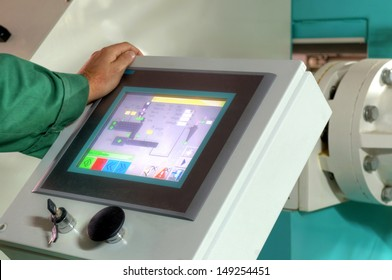 pressing important technology button at control panel in plant