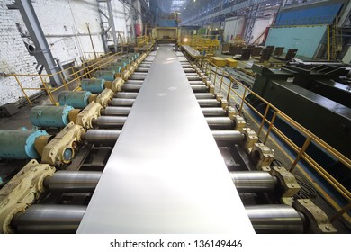 Pressing machine of rolling mill from a block of aluminum makes a sheet