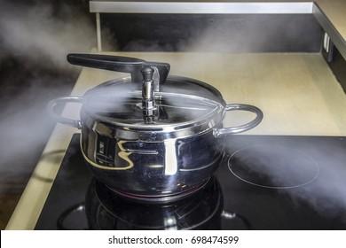 Pressure cooker releasing hot steam