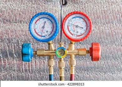 Pressure gauge for auto air conditioner recharge.