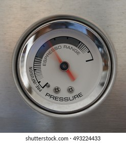 Pressure gauge of an espresso maker, needle moving in the perfect espresso range