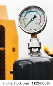 pressure gauge for measuring installed tractor, bulldozer or other construction machinery. focus on pressure gauge