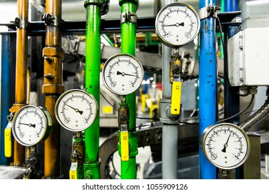 Pressure gauge, measuring instrument close up. Hydraulic pressure gauges installed on hydraulic equipment