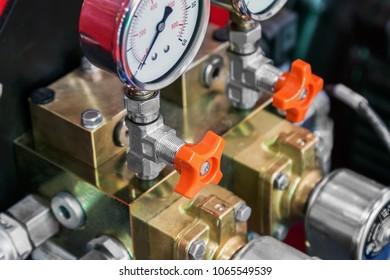 pressure gauge for measuring water or installed in gas systems. focus on the handles adjustment