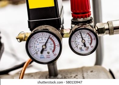 The pressure gauge on the air compressor half full