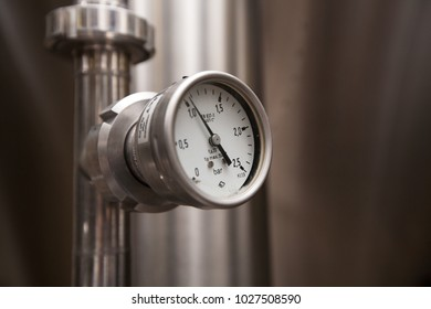 Pressure gauge of white metal -  brewing equipment. Close-up, macro.