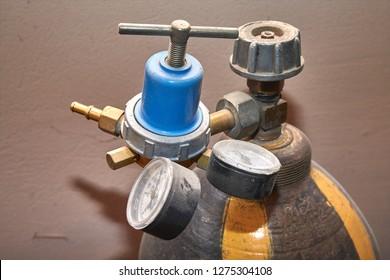 Pressure gauges and valves of gas cylinders