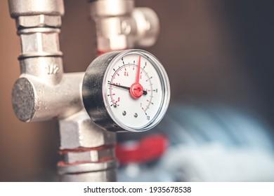 pressure increase in the pipe. manometer closeup.